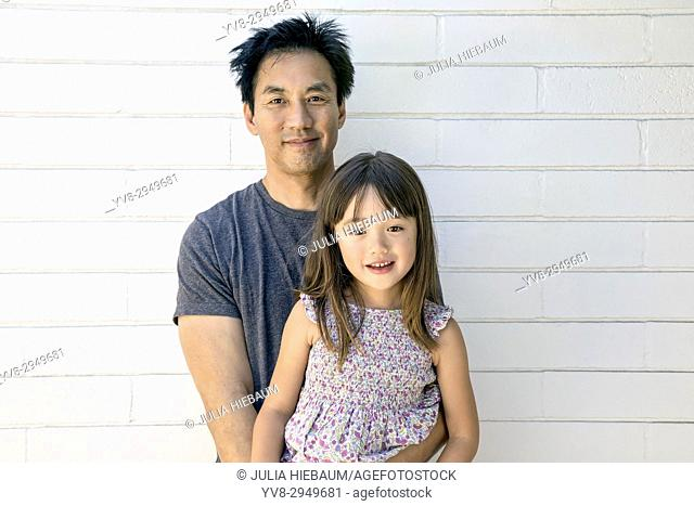 Asian father with his five year old daughter