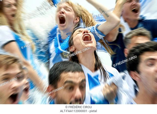 Argentinian football fans shouting while watching football match