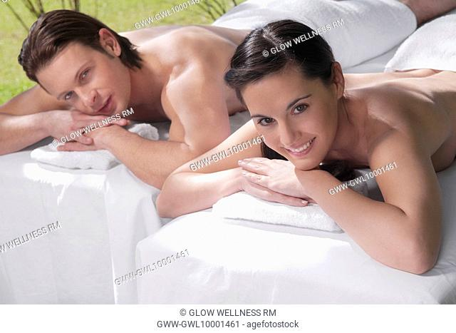 Couple lying on massage tables