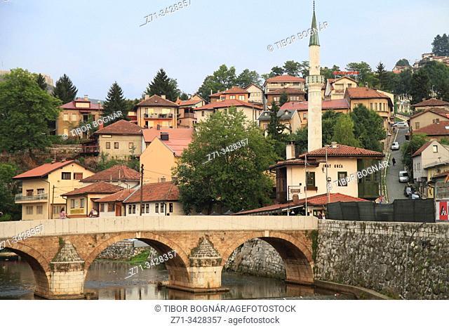 Bosnia and Herzegovina, Sarajevo, Seher Cehaja Bridge, Miljacka River, Spite House, minaret