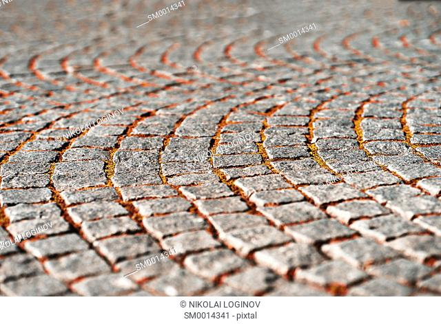 Diagonal medieval Norway pavement with autumn grass background hd