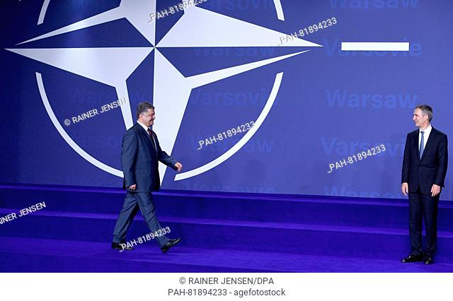 Nato General Secretary Jens Stoltenberg (r)welcoming Polish President Andrzej Duda at the national stadium in Warsaw, Poland, 8 July 2016