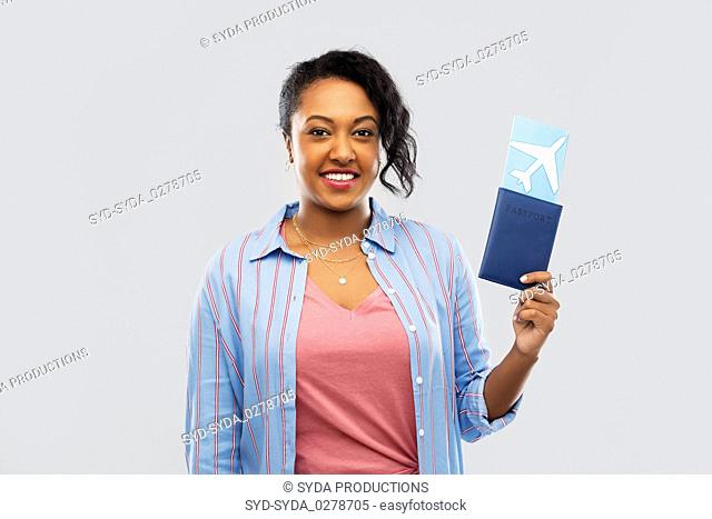 african woman with passport and air ticket