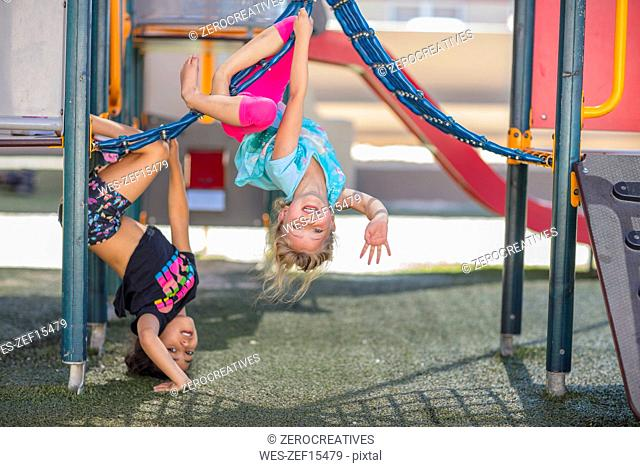 Happy girls playing on playground of a kindergarten