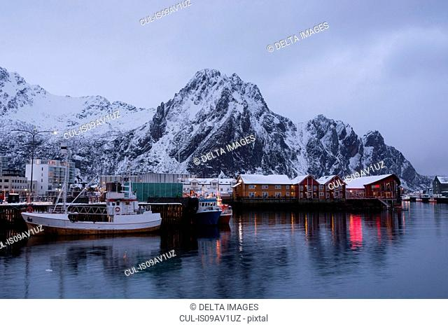Waterfront harbor and fishing boats at dusk, Svolvaer, Lofoten Islands, Norway
