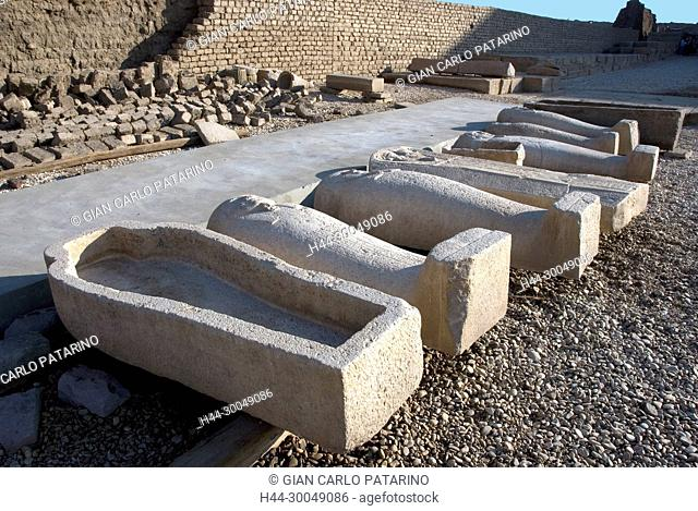 Egypt, Dendera, Ptolemaic temple of the goddess Hathor.View of various stone coffins