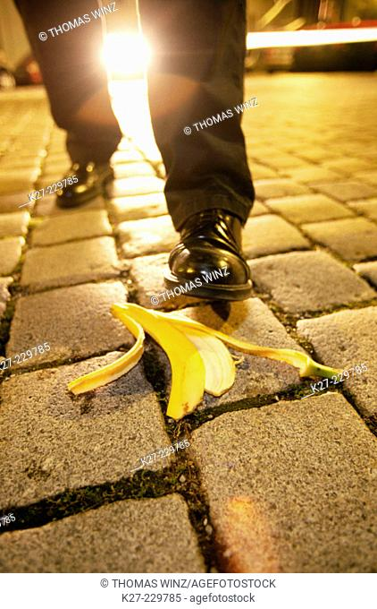 Man walking towards banana peel