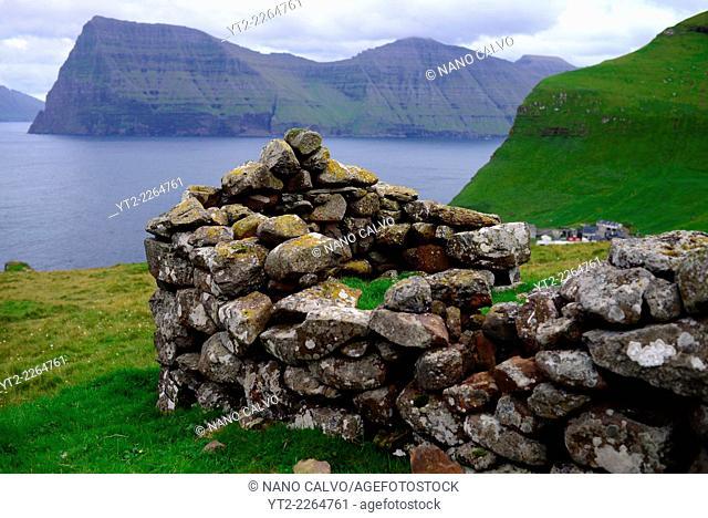 Stone mountain building in Trøllanesi, Kalsoy, Faroe Island