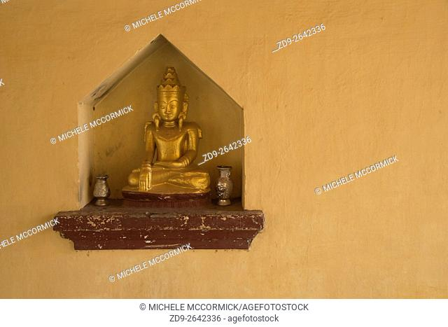 A small Buddha in a niche at Shwezigon Pagoda
