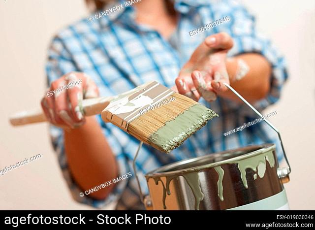 Home improvement Young woman with paint roller