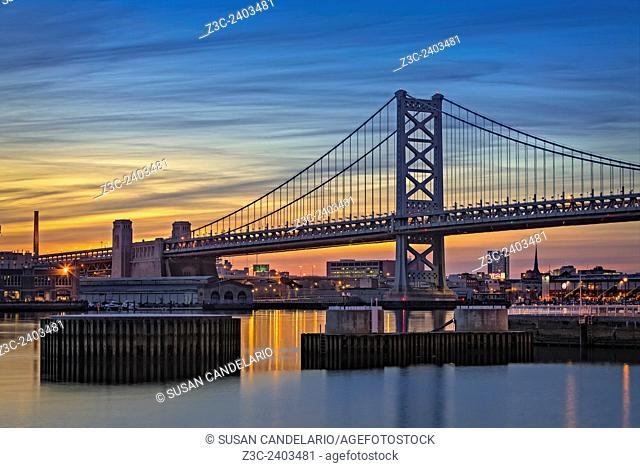 Ben Franklin Bridge - A view to the Delaware River with the Ben Franklin Bridge during sunset. The Benjamin Franklin Bridge