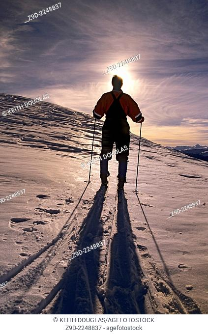 Backcountry skier silhouette at sunset, Hudson Bay Mountain, Smithers, British Columbia
