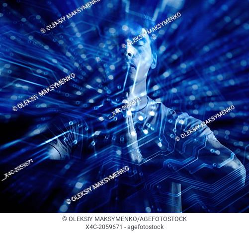 Conceptual portrait of a man meditating with his hands clasped together surrounded by digital circuits, electronics and technology