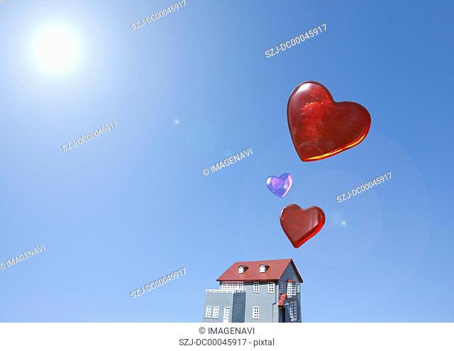 Miniature house and hearts