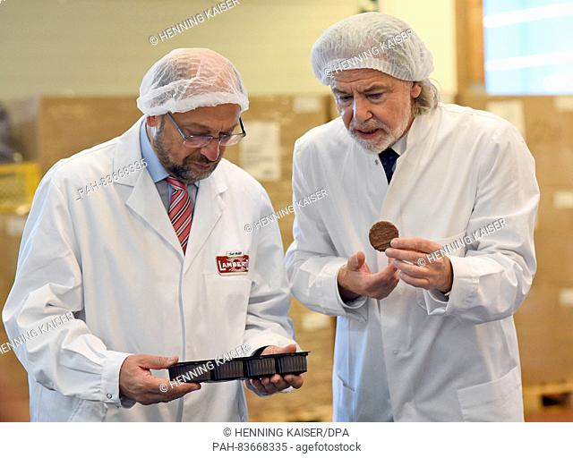 CEOHermann Buehlbecker (r) and the president of the European Parliament, Martin Schulz (l), visiting the production of chocolate and cookies at the chocolate...