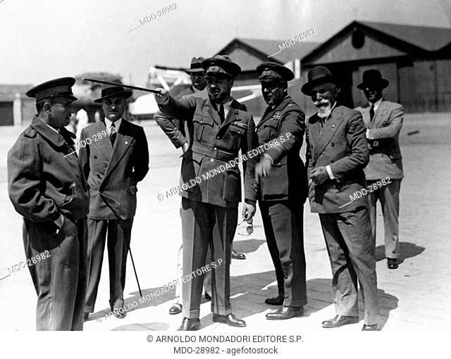 Italo Balbo with officers. Minister of Italian Air Force Italo Balbo talking with officers of the Italian army. Among them there is Galeazzo Ciano