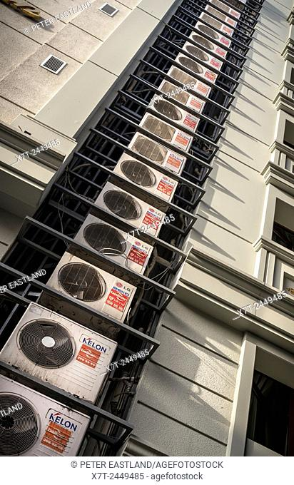 Multiple air conditioning units attached to the side of a modern hotel building in Sultanahmet, Istanbul, Turkey