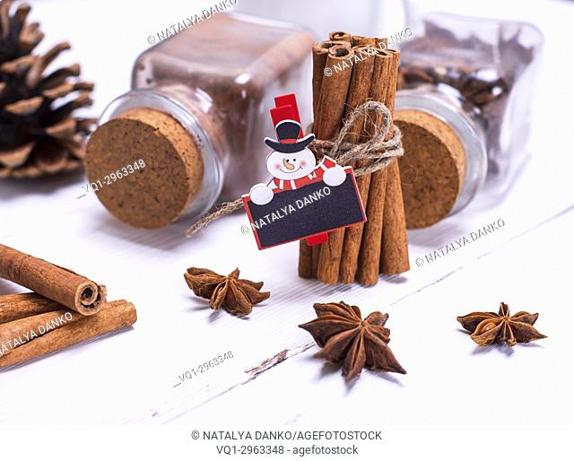 spices cinnamon and star anise on white wooden background