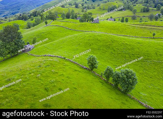 Aerial view with a drone of the spring landscape of pasiegas cabins and meadows in the Miera Valley in the Autonomous Community of Cantabria