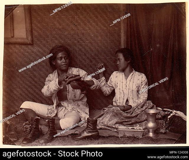 Servants, Batavia. Artist: Unknown; Date: 1860s-70s; Medium: Albumen silver print from glass negative; Dimensions: 16.5 x 21.6 cm (6 1/2 x 8 1/2 in