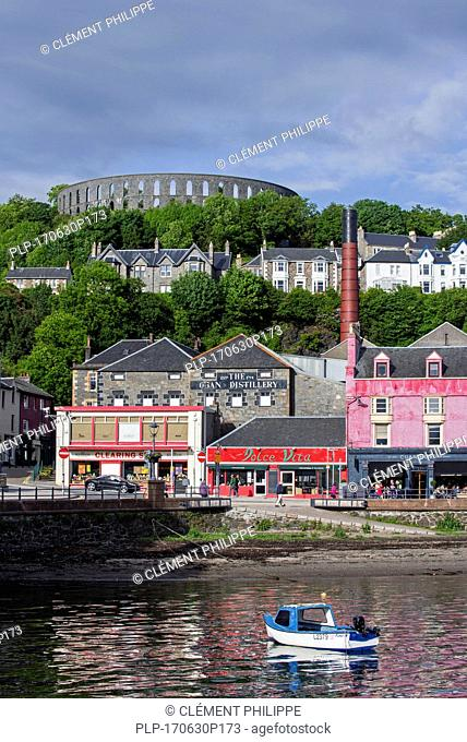 Oban Distillery and McCaig's Tower on Battery Hill overlooking the city Oban, Argyll and Bute, Scotland, UK