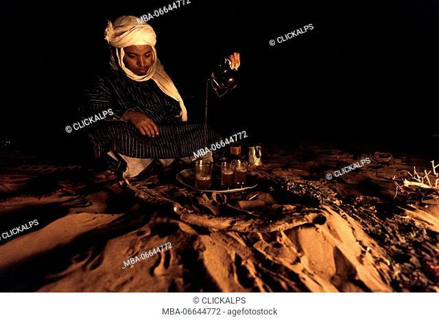 Sahara desert, Morocco. Bonfire in the night camp