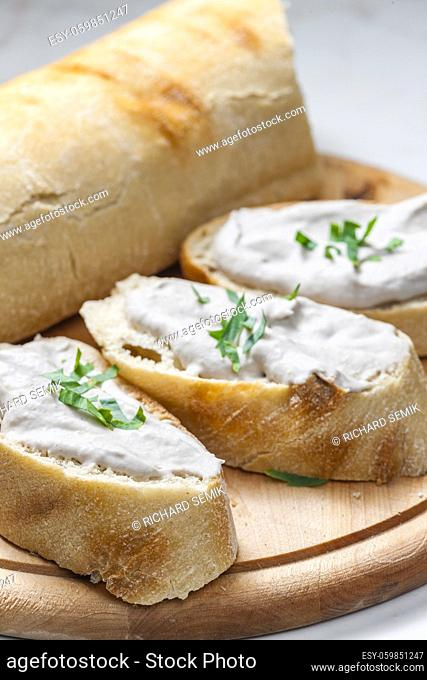 anchovy spread on white baguette