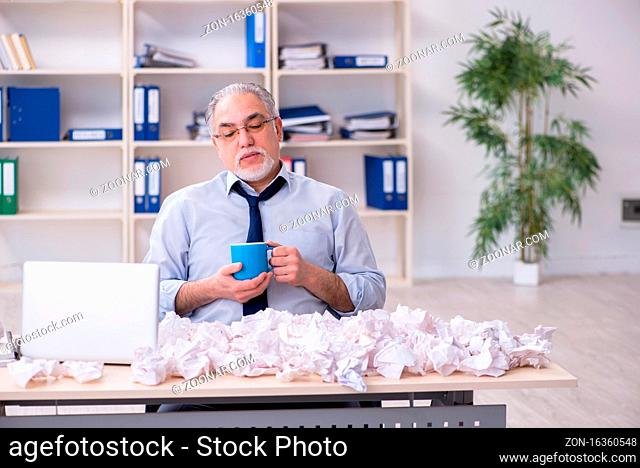 Old businessman rejecting ideas with lots of papers