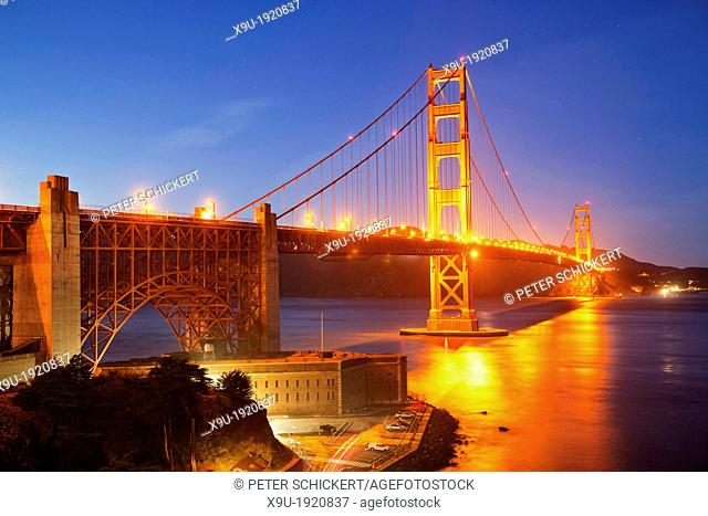 illuminated Golden Gate bridge and Fort Point National Historic Site in San Francisco, California, United States of America, USA