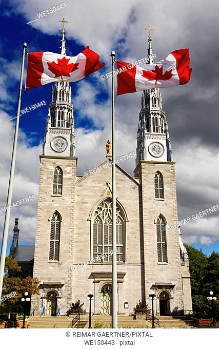 Front of Notre Dame Roman Catholic Cathedral Basilica in Ottawa with Canadian flags