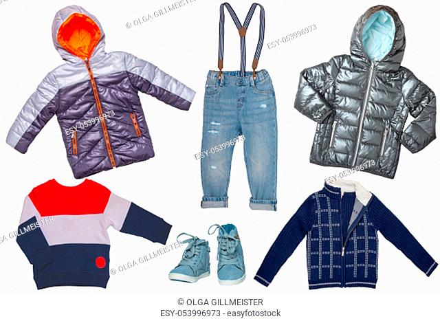 Collage set of children clothes. Denim jeans or pants, a pair shoes, two rain jackets, cardigan and sweater for child boy isolated on a white background