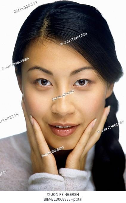 Asian woman with head in hands