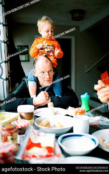 Grandfather with his grandson during breakfast