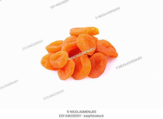 Close up of bowl with different dried fruits. Healthy food. Isolated white background