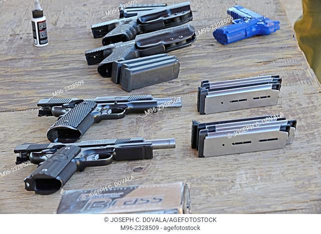 Unloaded pistols on bench, outdoor shooting range, Santa Clarita, California, USA