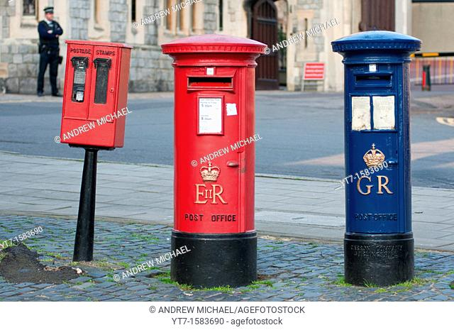 A blue Royal Mail post box George Regina next to a more common red one Elizabeth Regina in Windsor, Berkshire, UK