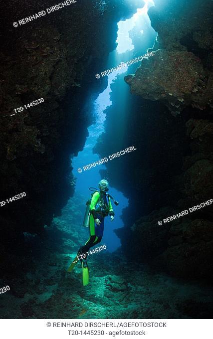 Scuba Diver in Underwater Cave, Namena Marine Reserve, Fiji