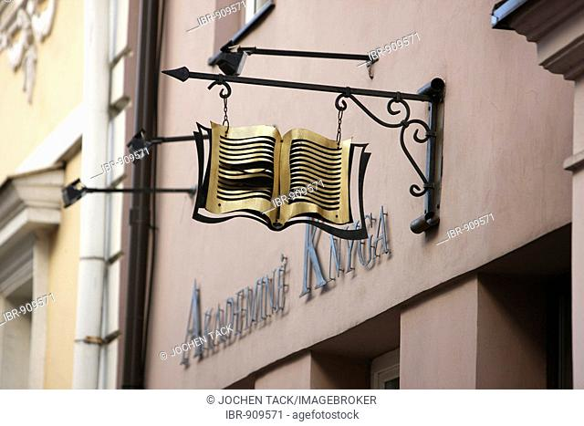 Sign in the shape of a book outside a bookshop in the university district of the historic city centre of Vilnius, Lithuania, Baltic States, Northeastern Europe