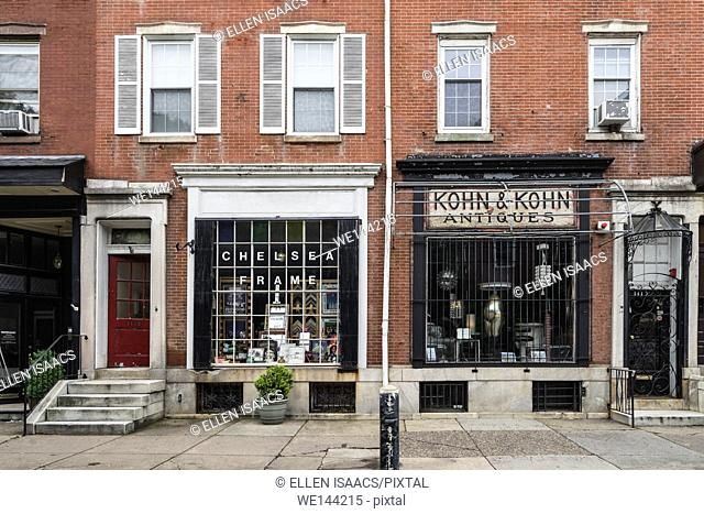 Two old-fashioned brick and mortar stores along Antique Row on Pine Street in Philadelphia