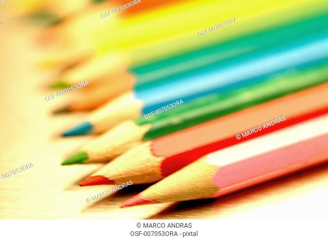 colorful pencils lined up side by side