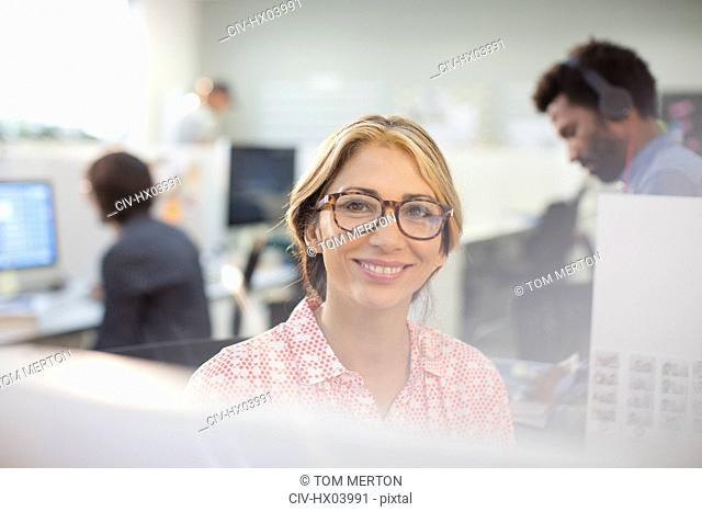 Portrait smiling, confident businesswoman in eyeglasses