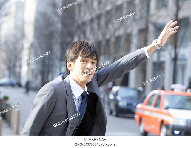 Businessman stopping a taxi