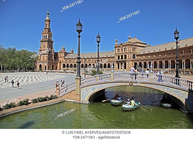 Tourists enjoying the boats in the Plaza of Spain, Sevilla, Spain