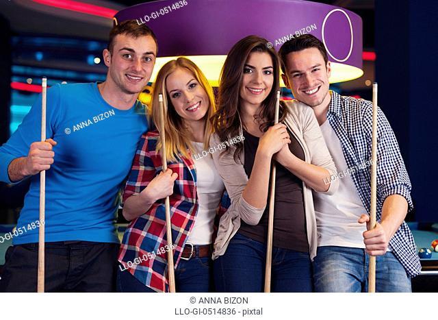Portrait of group of friends on billiard. Rzeszow, Poland