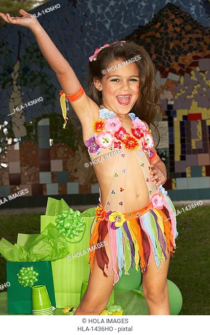 Close-up of a girl dancing at a birthday party