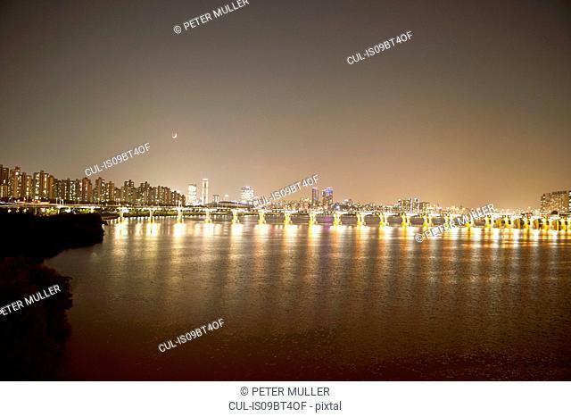 Illumination of Banpo Bridge reflected in water, Han River, Seoul, South Korea