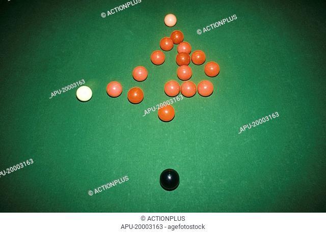 White ball breaking a rack of snooker balls