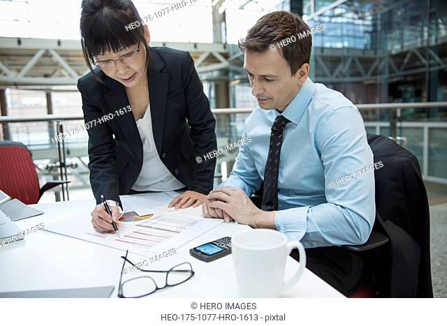 Business people reviewing data in meeting