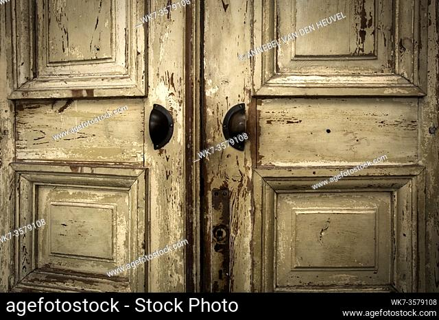 Old vintage wooden doors, grunge and antique background texture, opening closeup