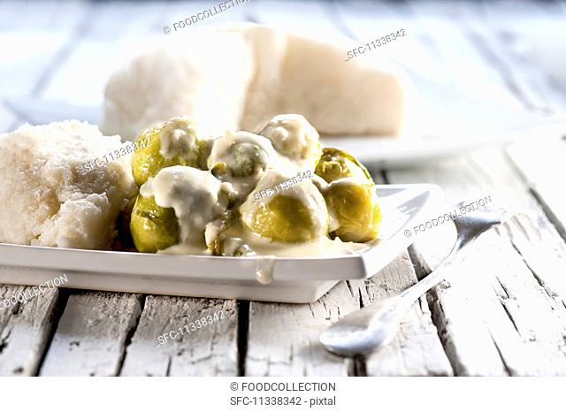 Brussels sprouts with white polenta and a cheese sauce